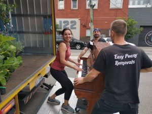 Prahran to Patterson Melbourne moving job Dec 2020 Playing the piano while loading it onto the truck